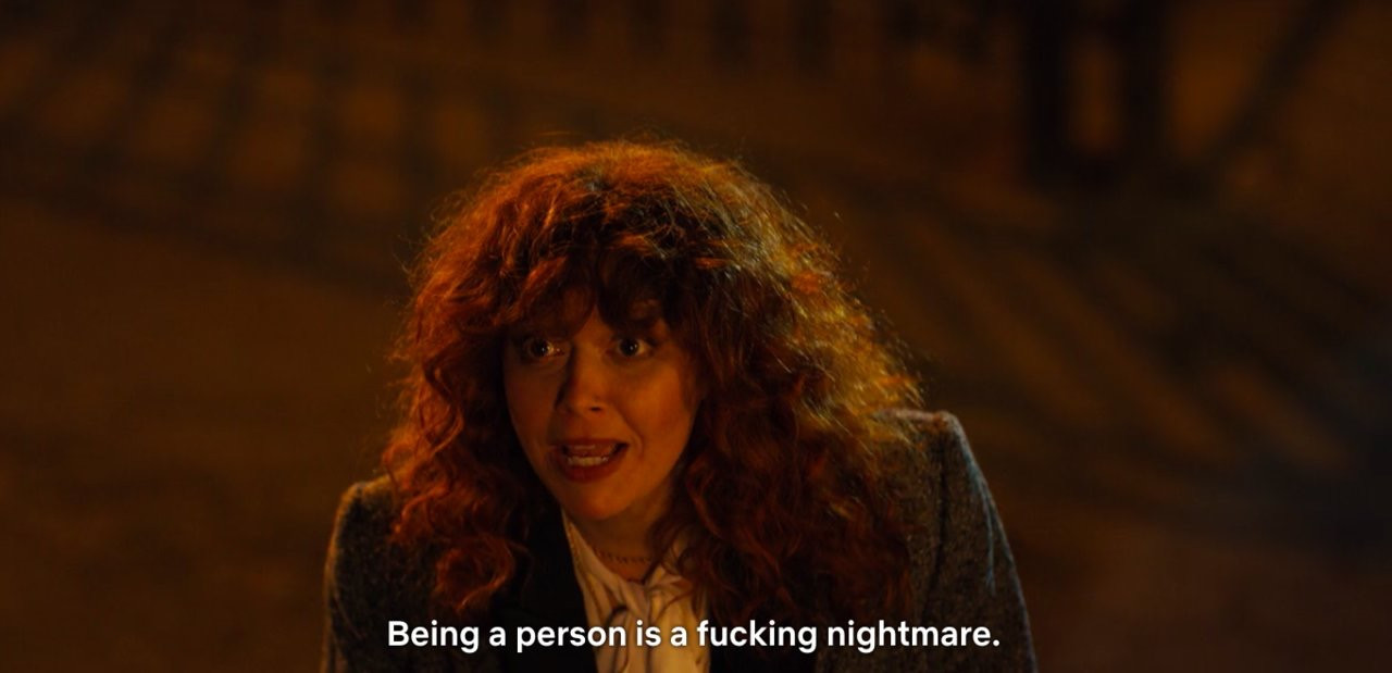 woman with curly hair with a subtitle, being a person is a fucking nightmare